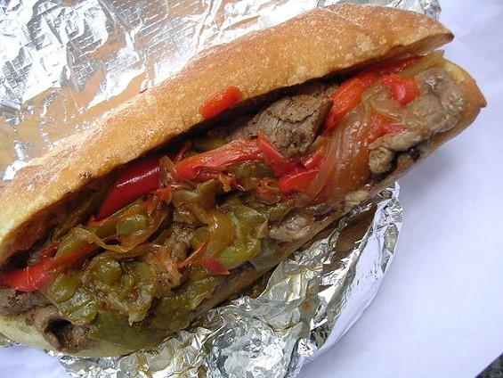 Marinated tri-tip sandwich, caramelized onions, Creole mustard ($9). - JOHN BIRDSALL