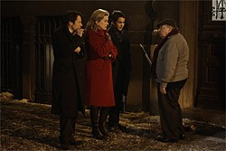 Mathieu Amalric, Catherine Deneuve, and Emile Berling head to midnight Mass.
