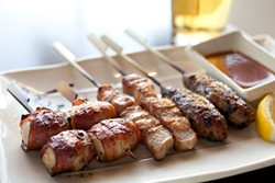 LARA HATA - Meal on a stick: scallops, pork, and chicken.