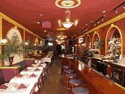 ANTHONY  PIDGEON - Memorable Mediterranean: Piyassa's narrow, supper-clubbish space is done up in warm red and gold tones.