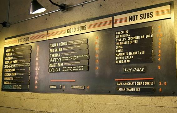 Merigan's menu, now with subs in the $10-$13 range. - JENN PRIES
