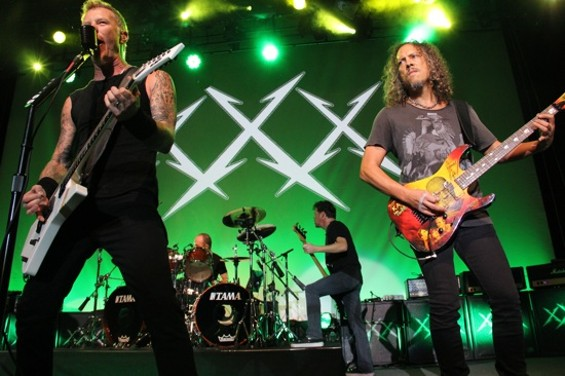 Metallica at the Fillmore on Monday night, with former bassist Jason Newsted in the background.
