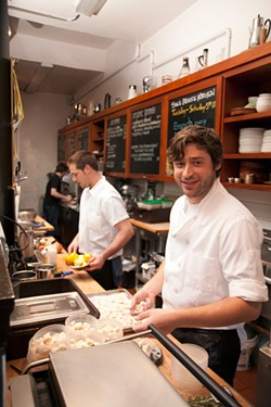 LARA HATA - Michael Mauschbaugh (right) in the modest Sous Beurre Kitchen.