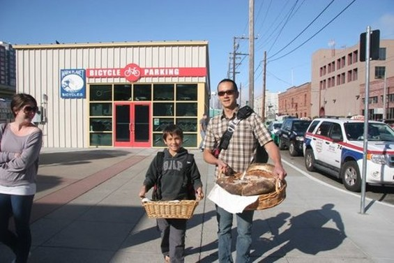 Michael Shwe and his son get ready to give out bread.