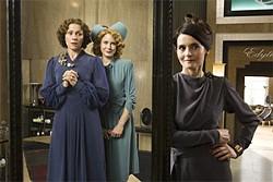Miss Pettigrew (Frances McDormand, left) admires her extreme makeover.