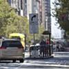 Mixed Up Minivan Meanders Down Market Street