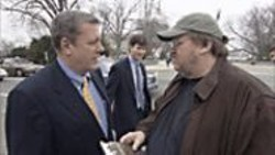 Moore Support: The filmmaker (right) talking - to pro-war Congressman John Tanner to - see if he could recruit the Democrat's - children to fight in Iraq.