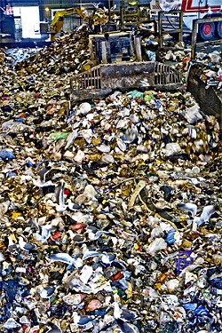 "JARED GRUENWALD - More than a thousand tons of garbage are deposited daily at ""The Pit"" in southeast San Francisco before being trucked across the bay to the Altamont Landfill."
