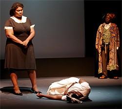 MARC PÂQUETTE - Mrs. Breedlove (Tamiyka White) stands over her daughter, Pecola (Shanique S. Scott).