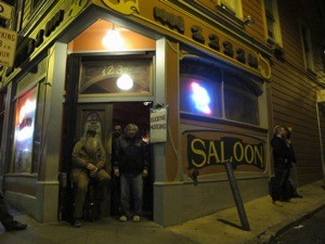 Mu with Greg, the Saloon's bearded bouncer.