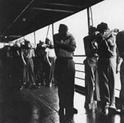 TIMEPIX - Navy men aboard ships used in the 1946 Operation - Crossroads nuclear tests were instructed to shield - their eyes for protection from the atomic blasts.