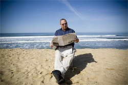 JAKE POEHLS - Newsom on the beach near his home in Montara.