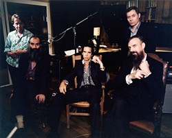 CAT STEVENS - Nick Cave, center, brings up Wikipedia, Miley Cyrus, and the Higgs Boson in the lyrics to his new album.