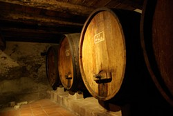 PHOTOGRAPHS BY IAN S. PORT - NIneteenth-century wine casks in an old cellar at Sobon Estate, Amador County.