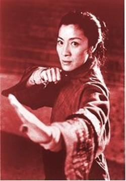 CHAN KAM CHUEN - Not Crouching, Fighting: Michelle Yeoh has the impact of a thunderbolt.