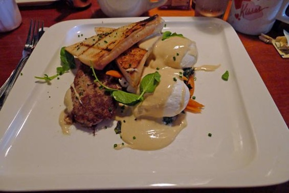 Old school style pork confit hash: poached eggs, chili braised kale, baby carrots, grilled bread, black garlic hollandaise