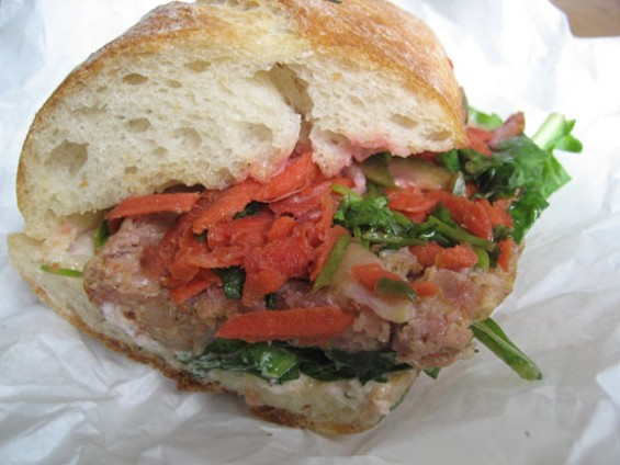 One of the variations of Aunt Malai's Lao sausage sandwich, $8.25, at Pal's Takeaway. - JONATHAN KAUFFMAN