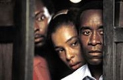 BLID  ALSBIRK - Ordinary People: Paul (Don Cheadle, front), - a Hutu, shelters his wife, Tatiana (Sophie - Okonedo), and hundreds of other Tutsis.