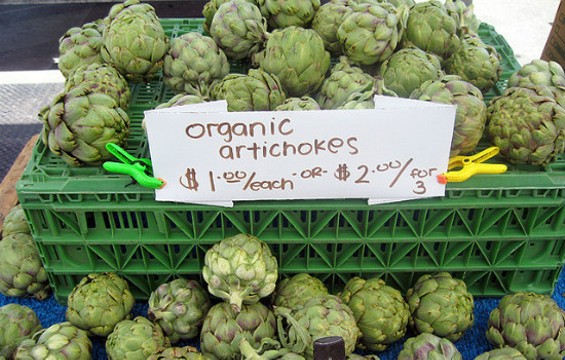 Organic artichokes at the Ferry Building Farmers Market. - FLICKR/SUMMERTOMATO