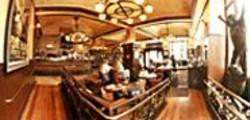 JAMES  SANDERS - Over-the-top décor at the Petit Cafe blends - art nouveau motifs with life-size sculptures.