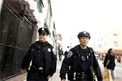PAOLO VESCIA - Patrol Special Officer Hanley Chan (right) and his partner Thomas Wong walk Polk Street.
