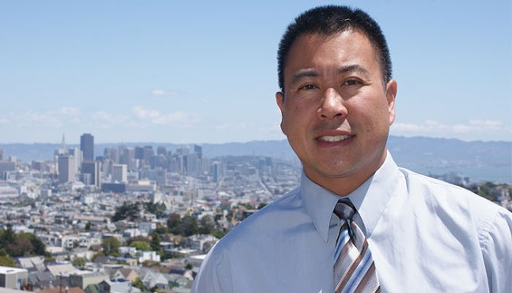 Paul Miyamoto poses at the vista point where every candidate for office in San Francisco has his or her photo snapped