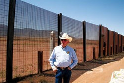 """PAUL RUBIN - Paul Rubin - Cochise County Sheriff Larry Dever at the fence near Naco: """"There are good people coming over here looking for jobs, I understand that. But bad guys are coming in and will continue to come in."""""""