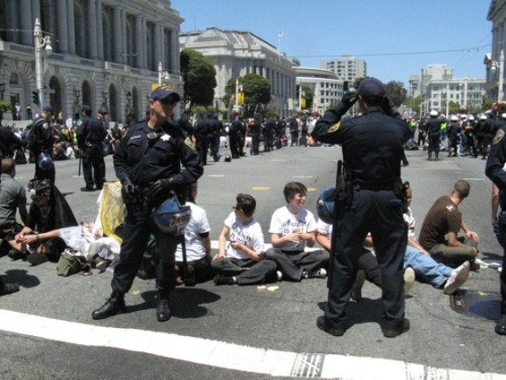Peaceful demonstrators shut down the intersection of Van Ness and Grove