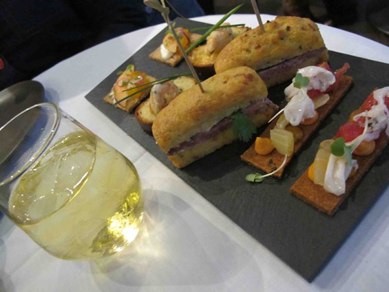 Peach oolong iced tea and a first course, including bánh mì financiers. - JESSE HIRSCH