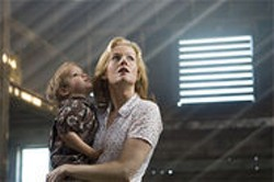 Penelope Ann Miller and creepy child in The Messengers.