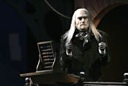 JOAN  MARCUS - Penny Pincher: Ebenezer Scrooge (Giles - Havergal) counts his dough on Christmas - Eve.
