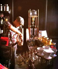 Phillip Ma pours a taste of the geisha. - MOLLY GORE