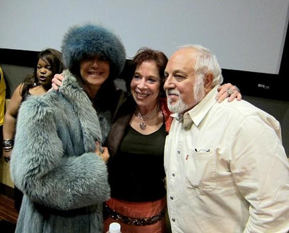 Photographer Robert Altman with fan and comrade.