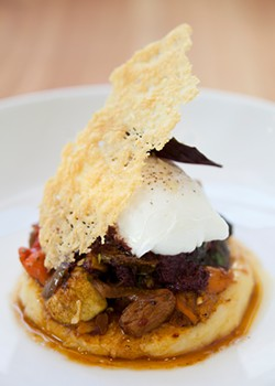 MELISSA BARNES - Piccino's signature dish: gnocchi with squash, black olive sauce, and an egg.