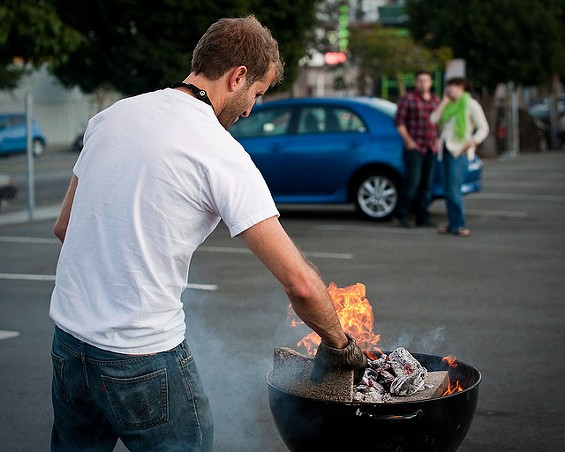 PizzaHacker's Jeff Krupman fires up the grill he transforms into a sidewalk pizza oven. - DAVE FAYRAM/FLICKR