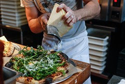 MIKE HENDRICKSON - PizzaHacker's Rocketman pie is adorned with freshly shaved cheese.