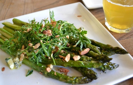 Pizzetta 211's seasonal asparagus dish captures the freshness of early spring. - ANASTASIA CROSSON