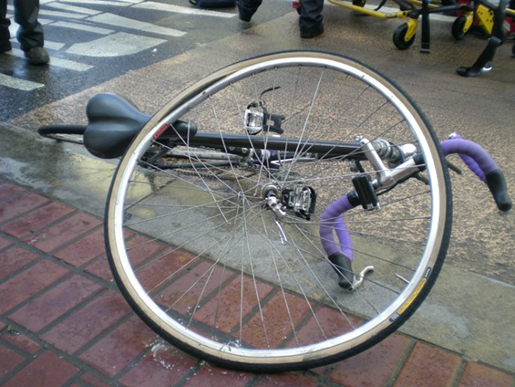 Police moved the cycle onto the sidewalk following the accident - JOE ESKENAZI