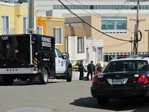 Police work the crime scene Friday afternoon - ALBERT SAMAHA