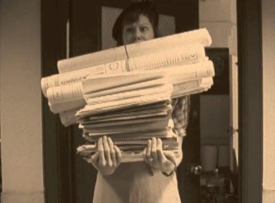 Polzine buried under paperwork in her old-timey Kickstarter video.