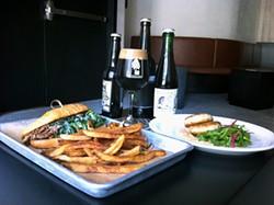 CAMILA BERNAL - Pork sandwiches and salt cod cakes taste good with fancy beer.
