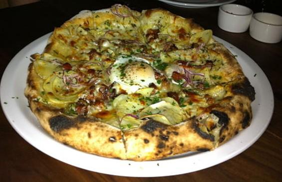 Potato pizza with bacon, egg, red onion, thyme, and Taleggio cheese, $15. - MICHELANGELO BATTAGLIA