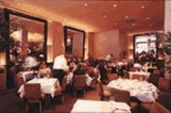 ANTHONY  PIDGEON - Pour Me Another: Passers-by can drink in Aqua's grand interior through - mirrors and big plate-glass windows.