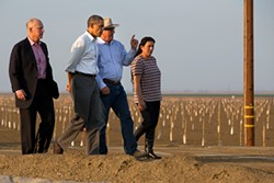 AP PHOTO/JACQUELYN MARTIN - President Barack Obama tours a drought-stricken local farm with California Gov. Jerry Brown (left) and Joe Del Bosque and Maria Gloria Del Bosque, of Empresas Del Bosque, Inc., in Los Banos on Feb. 14, 2014.