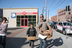 Proof Baking's Michael Shwe, with son and bread.