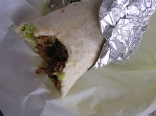Pure Gold?: Regular carnitas burrito (with guac) from La Taqueria. - JOHN BIRDSALL