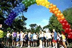 Rainbow balloons welcome runners.