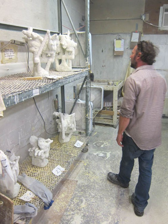 Randy Colosky inspects molds ready for the kiln.