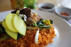 MIKE KOOZMIN - Red rice and pork belly: A dressed-up version of a simple, homey dish.