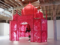 COURTESY OF HOSFELT GALLERY - Rina Banerjee's floating pink Taj, made from plastic, foam balls, and quilting pins.